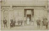 J Kirby's Picture and Frame Molding Warehouse: shop window with people in front.