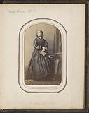 Portrait of a woman with a book in her hand, referred to as Aunt Kate