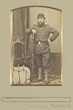 Portrait of a (presumably) French soldier standing by a knapsack with rifle