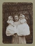 Portrait of a woman with two babies on her arm, probably the twins Ad and Johanna van der Kop with their mother WG …