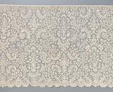 All-lace strip of bobbin lace with candelabra motifs