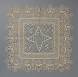 Tea table cloth made of bobbin lace with four-pointed star in diamond-shaped grid