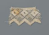 Strip bobbin lace with a row of windows and a wavy scalloped edge