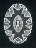 Lace design of an oval rug with butterflies in white ink on black cardboard