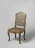 Chair in beech wood painted green, strung with cane, S-shaped legs, scalloped rails and carving of flower and leaf work