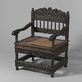 Tropical wood armchair with a loose seat frame covered with reed, the chair has slung colonets and is decorated with …