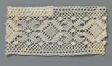 Bobbin lace insert with a row of diamonds surrounded by pointed ovals