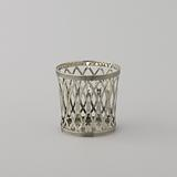 Two small and two larger baskets or holders, worked à jour with flung ovals and fillet edges along bottom and top