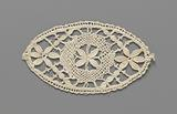 Bobbin lace design in the shape of an oval with a circle and three flowers in it
