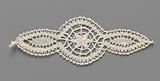 Motif of bobbin lace in the shape of a circle with a pointed oval on both sides