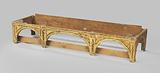 Frame of a gilt pinewood cassone, formed by three arches with colonets