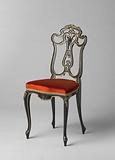 Chair, alternately painted glossy and dull black and decorated with gilded edges and some gold-coloured fittings.