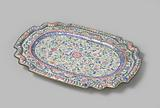 Copper top, oval with scalloped corners, on four legs and decorated with floral scrolls