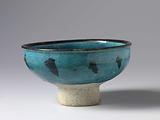 Bowl with a stylized flowering plant