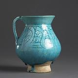 Pear-shaped ewer with an inscription and foliate scrolls