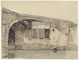Old bridge with house or cellar windows under the quay