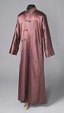 Dressing gown with narrow collar, long sleeve with turn-up and flap closure with three braided tresses and buttons, of …