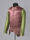 High-necked sleeve vest with two low pockets with flaps and 11 fabric buttons, fine red-green striped satin