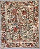 A bedspread of chintz, with a tree motif on white ground