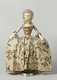 Wooden doll with glass eyes and human hair style, dressed in a frock (demi-parure) of flowered chintz, consisting of …