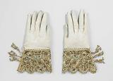 White wash leather glove, with scalloped hoods with gold lace, acorn and silk ties, embroidered with multicoloured …