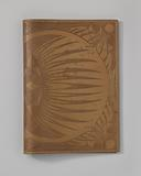 Leather book cover with pressed pattern of fish and butterflies