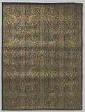 Wall covering of linen with print in gold on gray background with stylized tendril pattern inside windows in which …