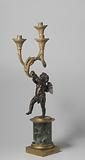 Candlestick with a bronze horn playing angel