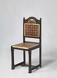 Chair covered with batik parchment in red, white and black diamond pattern