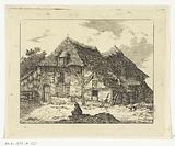 Man sitting on a hill in front of a house in Staphorst