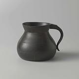 Pewter chamber pot with sloping raised edge