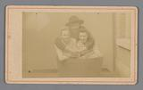 Portrait of two unknown women and an unknown man in a tub