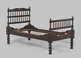 Wooden bed with twisted legs and with styles decorated with dolphins and acanthus leaves