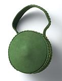 Round handbag in grass green peau de suede with copper ring and closure