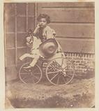 Lodewijk Asser, son of the photographer, on a tricycle
