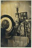 Still life with a photographic portrait of Asser, stereoscope and portfolio