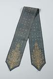 Bookmark in blue with batik pattern, including a tree motif in the pointed ends