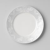 Dessert plate with symmetrical embossed leaf motifs