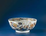 Punch bowl with flowering plants, pheasants, butterfly and carp