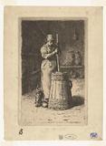 Woman churns milk in churn