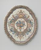 Plate, oval with scalloped edge, multicoloured painted with a medallion in which a flower vase between lambrequins