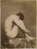 Study of a male nude model, sitting with the head in the knees, seen from the side