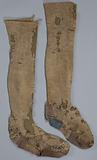 Knee socks, light brown, the hem is worked in purl stitch and there is a decorative seam from the hem to the heel