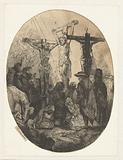 Christ crucified between the two thieves: an oval plate.