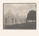A Buddhist shrine with a row of stupas (?) And a tree, South East Asia