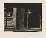 Man in a Doorway, Seen from a Car
