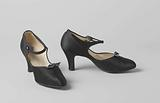 Black satin strap shoe with ankle strap and black tie with silver cord