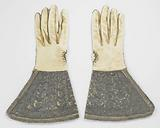 Leather glove with very wide caps, covered with blue satin, embroidered with silver thread and trimmed with silver …