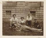 Dolph Kessler with friends on the grass in front of a house in Gainsborough