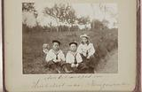 Three Vermeulen children in sailor suits by the side of the road
